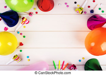 birthday party items on white wooden background. top view