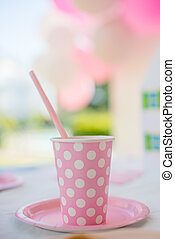 Birthday Party Pink Cup with Polka Dots Standing on Table