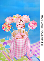 birthday party table with pink marshmallow pops  for kids