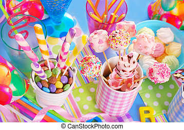 birthday party table with sweets for kids - colorful ...