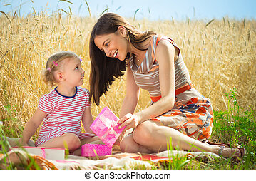 Birthday present for little girl at grain field