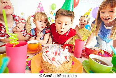 Birthday wish - Group of adorable kids gathered around...