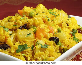 A colorful Indian rice dish made from basmati rices, spices, and fresh vegetables.
