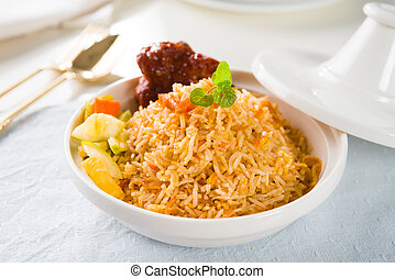Biryani rice or briyani rice, curry chicken and salad,...