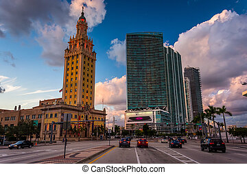 Biscayne Boulevard and the Freedom Tower at sunset in downtown Miami, Florida.