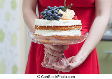 Biscuit cake with fruit hat
