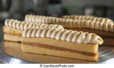 Biscuit cakes with condensed milk and cream on rotating cake...