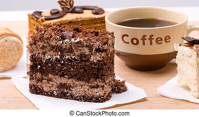 Biscuit cakes with cup of coffee