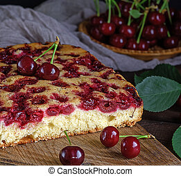 biscuit cherry pie on a brown wooden board