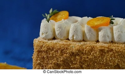 Biscuit layered cake with cream curd decorated with kumquat....
