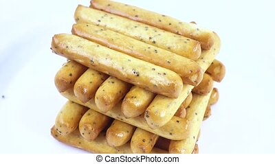 Biscuit sticks with poppy seeds