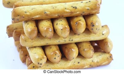 Biscuit sticks with poppy seeds - Stack of popcorn sticks...