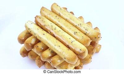 Biscuit sticks with poppy seeds - Stack of popcorn sticks...