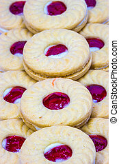 Biscuit with jam on white background