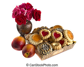 biscuits in a box, nectarines and roses