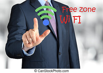 Bisinessman  in  a modern suit Touching   asign of wi-fi