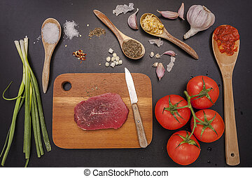 bistecca grezza, vegetables.