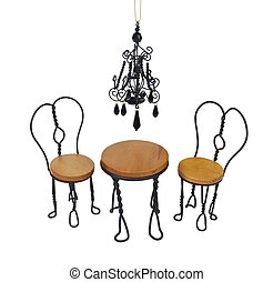 Black chandelier with black crystals hanging down over a bistro setting of chairs and table - path included