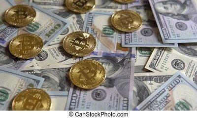Bit Coin BTC coins on bills of 100 dollars. - Gold Bit Coin...