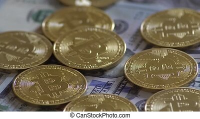 Bit Coin BTC coins rotating on bills of dollars. Virtual...