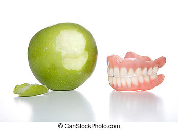 Bit the apple - False teeth just took a bit out of an apple
