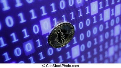 bitcoin against monitor with binary code. Crypto currency...