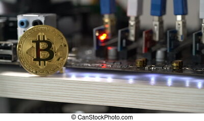 bitcoin against the background of the motherboard in the...