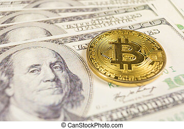 Bitcoin and banknotes of one hundred dollar