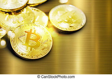 Bitcoin and bokeh light on gold metal background with copy space