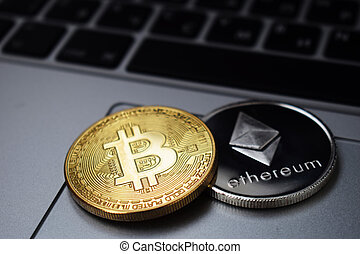 Bitcoin and Ethereum coins on a laptop