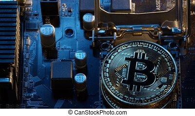 Bitcoin mining. BTC coins in CPU central processor socket on digital pc motherboard. Market trading cashless e-commerce. Gold bitcoin cryptocurrency isolated on computer board. New virtual money
