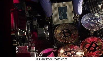 Bitcoin BTC, Ethereum coins on digital computer motherboard. Cryptocurrency mining. Businessman showing CPU processor. Finance trading, economics, virtual money, cashless future, blockchain technology