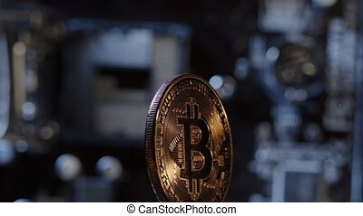 Bitcoin mining. Bitcoin BTC spinning on digital technology pc motherboard background. Market trading cashless e-commerce. Gold bitcoin cryptocurrency isolated on computer board. New virtual money