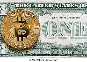 Bitcoin coin on dollar close up