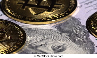 Bitcoin coins and dollar bills rotate on the table