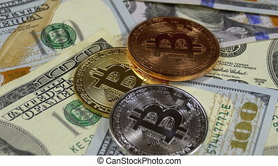 Bitcoin Coins BTC and Dollars Rotate. Crypto Currency...
