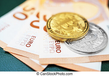 Bitcoin coins cryptocurrency lying on the euro banknotes.