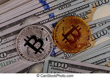 Bitcoin coins on background with US dollars