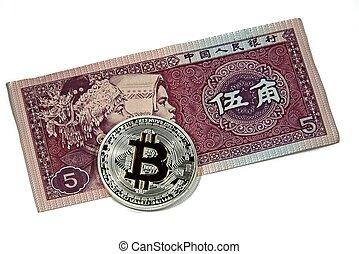 Bitcoin coins on China yuan note