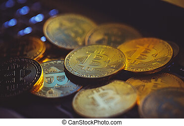 Bitcoin coins on laptop keyboard. Cryptocurrency concept.