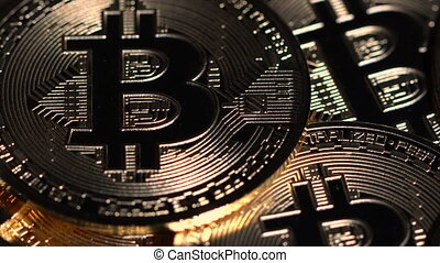 Bitcoin coins spin on the table