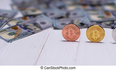 bitcoin coins with dollar bills