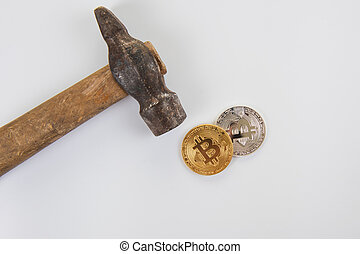 Bitcoin coins with hammer