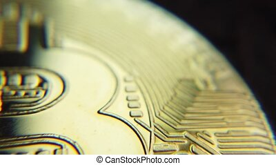 Bitcoin cryptocurrency gold coin macro shot. High quality 4k footage