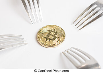 Bitcoin cryptocurreny coin placed between forks with reflection, hard fork