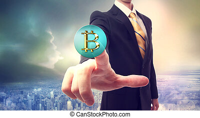 Bitcoin currency with businessman - Businessman pressing a ...