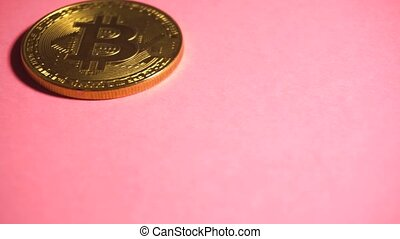Bitcoin gold coin at pink background. Digital crypto...