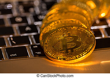 Bitcoin gold coin with computer keyboard. Virtual cryptocurrency concept.