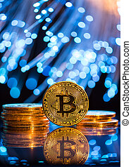 Bitcoin gold coin with defocused abstract background. Virtual cryptocurrency concept.