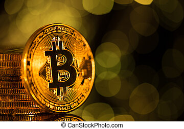 Bitcoin gold coins with defocused abstract background. Virtual cryptocurrency concept.